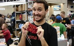Wil Wheaton << Holding a handknitted sock and grinning like a mad man. One of the coolest guys evAR.