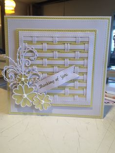 Lovely card made using Sue Wilsons weaving dies, sweetheart flowers and beaded swirl flourish, and banner dies.