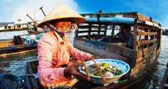 Enjoy Cai Be Floating Market and Homestay 2D1N. See the seasonally picturesque flat rice fields, observe the daily activities on the Cai be floating market, wander into the small villages