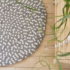 Grey felt ball rug - Se more in one of our websites:  Felt ball rug: http://unaliving.com  Kugletæppe: http://unaliving.dk  Filzkugelteppich: http://unaliving.de    We have 14 different designs, all made of wool!