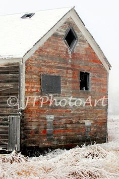 Title: Feed Building By: JTPhotoArt  Description: A once vibrant red feed building on a ranch in the bottom of a North Dakota slough is showing its age.