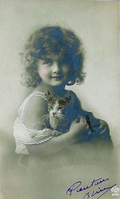 Girl with cat (real photo postcard)