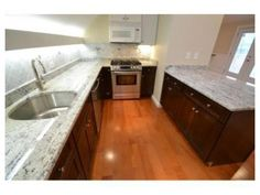 Another home that is currently available! Call 617-828-1070 for more information! Spacious, sparkling, and sleek kitchen!