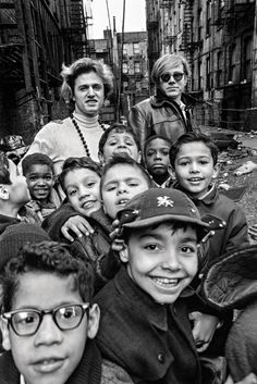 Gerard Malanga and Andy Warhol with Lower East Side schoolchildren. Photo: Larry Fink