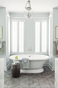 """Use Practical Materials - 65 Calming Bathroom Retreats - Southernliving. """"Laid out in a pattern, this Ann Sacks tile gives the same graphic punch as a painted floor but is much more practical for a bath,"""" says designer Phoebe Howard.  See more of the Nashville Idea House"""