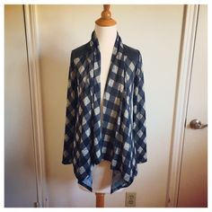 B&W Plaid Leather Cardigan This is a classic cardigan made edgy with the Leather inserts at collar and shoulders. Super cool, super soft and super brand new without tags. Sweaters Cardigans