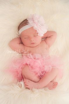 Baby Flower Headband- Newborn Headband- Light Pink Ruffled Chiffon Flower on Soft White Elastic Headband. $11.95, via Etsy.