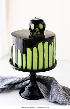 """Poison Apple Cake - a black mirror glaze cake with an edible """"poison apple"""" for Halloween 