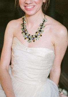 Modern green and purple statement necklace—so good for a fall wedding! {Photo by Taylor Lord via Project Wedding}