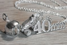 Roller derby skate necklace with additional pivot helmet charm and skate number charm.