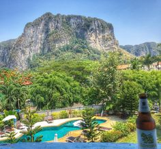 View from our hotel in Aonang Krabi. Beautiful beach and great weather! Can't enjoy it too much with my arm buts it's alllll good . Still loving life!! What do you like more Chang or Singha beer?? Drinking Singha for the first time. I like Chang a little more .. it's smoother but both are sick. #Chang #awesome #Singha  #beer #travel #backpacking #hotel #beaches #beach #mountain #pool #epic #sun #hot #vacation #pics #instalike #insta #krabi #thailand #travelbug #traveladdict #exploring…