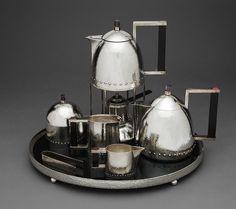 Josef Hoffmann (Austrian, 1870–1956) Tea service, ca. 1910  Silver, ebony, amethyst, carnelian; H. (large teapot) 5 3/8 in. (13.7 cm) Cynthia Hazen Polsky and Leon B. Polsky Fund, 2000 (2000.278.1–.9)