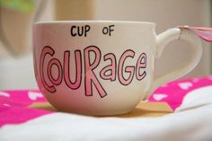 cowardly lion..teacup......cup of courage.  Can make this into a cardboard cup that goes on the doors of dorms with names added.