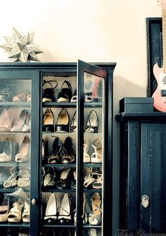 Use a china cabinet for shoe storage and display... brilliant AND fabulous!