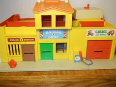 1970s Fisher Price Little People Town. Of course we had to have to other side of the street too!