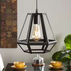 Give the lantern a contemporary spin with this geometric pendant lamp. Matte black metal works into a captivating, functional cage; customizable cord length puts power in your hands. Downlight facing open f Led Lantern, Lantern Pendant, Pendant Lamp, Pendant Lighting, Home Lighting, Modern Lighting, Lighting Design, Black Pendant Light, Light Fixtures
