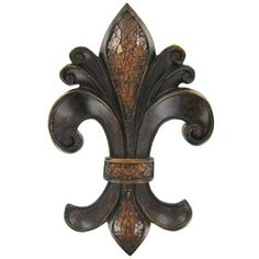 "This Fleur-De-Lis Wall Plaque is beautiful hung alone or it can be coordinated with similar pieces to add a warmth and artful touch to any decor.    	The piece measures 7 3/4"" wide x 12"" tall x 1"" thick and hangs from a sawtooth hanger in the back of the piece."
