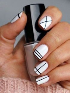These easy stripes are the perfect nail art design for short nails. Click above to get more easy nail designs for shorter nails.