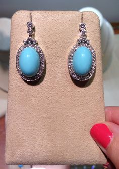 Oval turquoise earrings with 1.29ctw of round diamonds from Becker's!