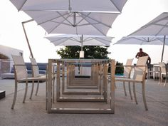 Umbrellas - Royal Botania. We came too late to invent the umbrella, but not to reinvent it. Looking at the fine woodwork, the shiny stainless steel fittings, the superb acrylic covers, you will realize, the Royal Botania umbrellas are way beyond what you have seen before. Sheer luxury.  #outdoor #furniture #umbrella #luxury #RoyalBotania