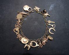 Mid-Century Charm Bracelet 9k/18k Rose Gold, British c. 1948-51 www.bavier-brook.com