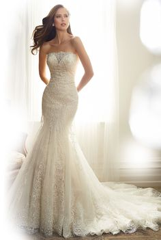 Sophia Tolli - Alouette. Misty tulle Alouette features delicate hand-beading coupled with tender lace appliqués, emphasizing the distinct quality of the design. Scalloped lace highlights the strapless neckline featuring a semi-sheer modesty panel while lace and beading follow the curve of the body to enhance a woman's silhouette.