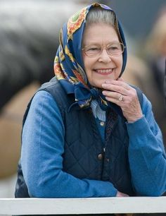 Queen Elizabeth II.  I love this... she looks like anyone's sweet grandmom enjoying a little outing. <3