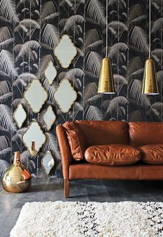 = low hung gold pendants, leather sofa and mirror cluster