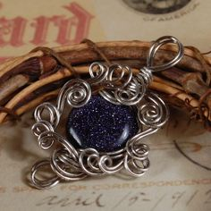 Blue goldstone, antiqued silver wire. I'm pretty sure I've only listed this once, but if it turns out that I was so tired I not only couldn't count but couldn't spot it on the website, I can make another one very very similar.