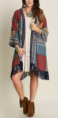 60% cotton, 40% polyester. Wrist length cuffed sleeves. Open cardigan jacket with fringe hem The fabric is gorgeous! Casual wear at it's best. You can dress this up or down, it is a wonderful addition