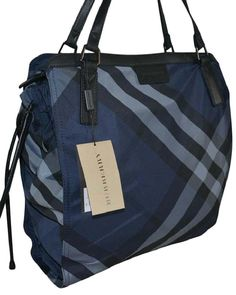 Burberry Nwt Nylon Nova Check Overnight Navy Blue Tote Bag. Get one of the hottest styles of the season! The Burberry Nwt Nylon Nova Check Overnight Navy Blue Tote Bag is a top 10 member favorite on Tradesy. Save on yours before they're sold out!