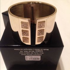 """VS 2014 Limited Edition SCANDALOUS Cuff Bracelet STUNNING GOLD TONE CUFF-BRAND NEW IN BOX The newest Victoria's Secret bracelet will wrap your wrist in sexy rhinestone pyramid studs.  78.00 RETAIL - and limited release Condition: New with tags Brand: Victoria's Secret Length (inches): 3.75""""L x 2.75""""W x 2.5""""H Metal: 85% zinc 10% glass 5% steely Style: Cuff Main Color: Gold Victoria's Secret Jewelry Bracelets"""