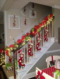 Tied stocking's to railings with ribbon. Hung ornaments on antique picture frames