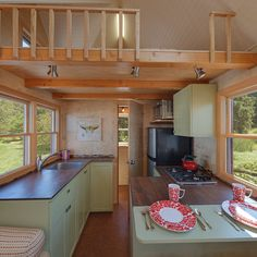 Beautiful open kitchen and lovely counters and cabinets. Cork floor | Explore Seattle Tiny Homes' Ballard Model with this interactive panoramic virtual tour. | Tiny Homes