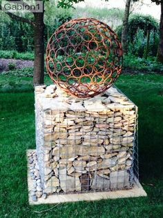 This is inspired by a solid stone cube and solid stone ball in Goethe's garden at Weimar in Germany. Built on a single 900mm cube gabion, in a London garden http://www.gabion1.co.uk