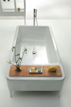 This is my first pin. I liked the tapered feet and the mix of materials. wood, ceramic, porcelain, bathtub