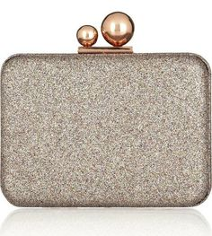 Sophia Webster's glitter clutch is majorly festive, and those two circle clasps set it apart from all the other glittery clutches out there.