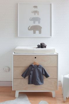 Nursery changing table. I really like the change table mattress on top of a regular chest of drawers