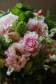 Beautiful pink and green floral arrangement. Love the strawberries!