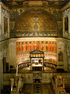 "San Clemente, Rome.  View of the Asp, richly decorated with frescoes and mosaics, of the 12c.  Notice the large and impressive fresco panel of ""Christ and Our Lady with Eleven Apostles ""."