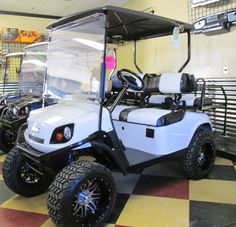 19TH HOLE GOLF CARTS - WHITE EZGO GOLF CART WITH CUSTOM UPHOLSTERY