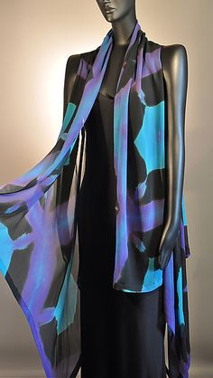 This is a hand-dyed silk chiffon vest. The Tortoise Shell resist dye pattern is a result of the process known as Itajimi Shibori. Solid black silk fabric is accordion pleated, board clamped and bleached in a discharge solution. Wash off and additional colors are layered in to the fabric to create a subtle depth in a traditionally Japanese pattern.