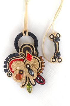 Unique, handmade soutache jewelry necklace. Orange, cream/beige, green, red, black, gold colors combination. The back is made of leather. Necklace length:23-23 cm/9,05-9,05 inches. Pendant size:6x9 cm/2,23x3,54. The set will be shipped nicely wrapped,in silk (organza) jewelry