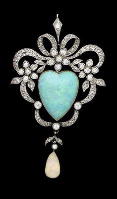 An opal and diamond brooch / pendant, ca.1890.