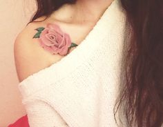 Very silky and delightful colored tattoo on right collarbone. Pink color rose looks very sensitive and feminine! Also there is some green rose leaves. Very nice work :)