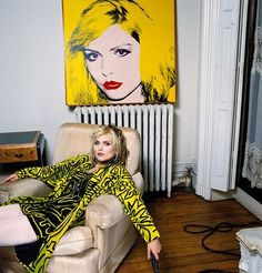 Debbie Harry from Blondie with her portrait by Andy Warhol