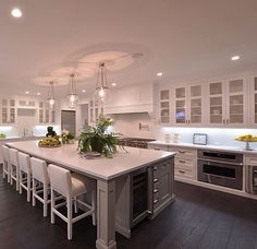 Awesome Large Kitchen Island With Seating And Hanging Lamps. This picture is one of many ideas on best large kitchen island with seating. Large Kitchen Design, Huge Kitchen, Kitchen Ideas Large, Large Kitchen Island Designs, Large Kitchen Layouts, Kitchen White, Awesome Kitchen, Rustic Kitchen, Kitchen Designs