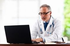 Doctor looking at record computer - Google Search