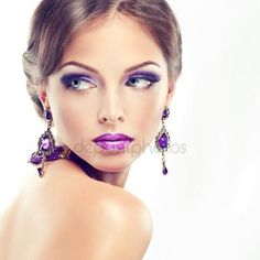 Download - Model with jewelry earrings and  violet makeup — Stock Image #121554516