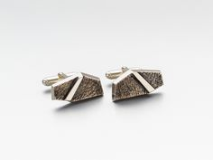 One of a kind sterling silver cufflinks signed by contemporary jewelry designer David Sandu.